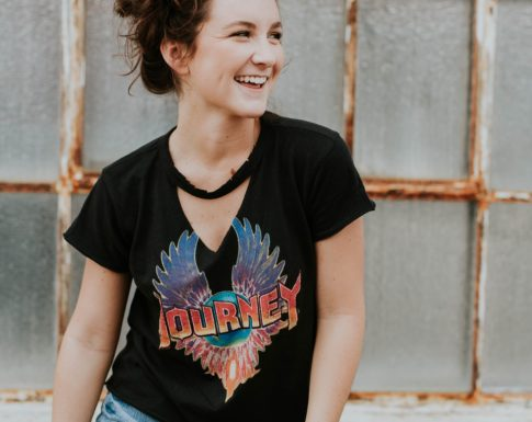 Smiling teen girl in Journey tshirt